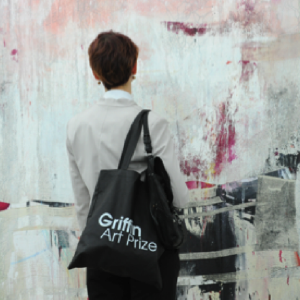 Griffin Gallery visitor with branding bag